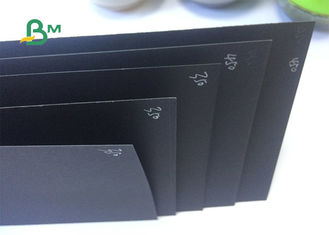 100% Virgin Pulp Permukaan Glossy Recyclable Black Paper Untuk Hardcover